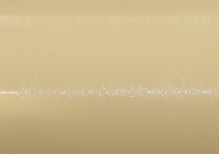 Oberfläche einer Lioret-Zelluloidwalze